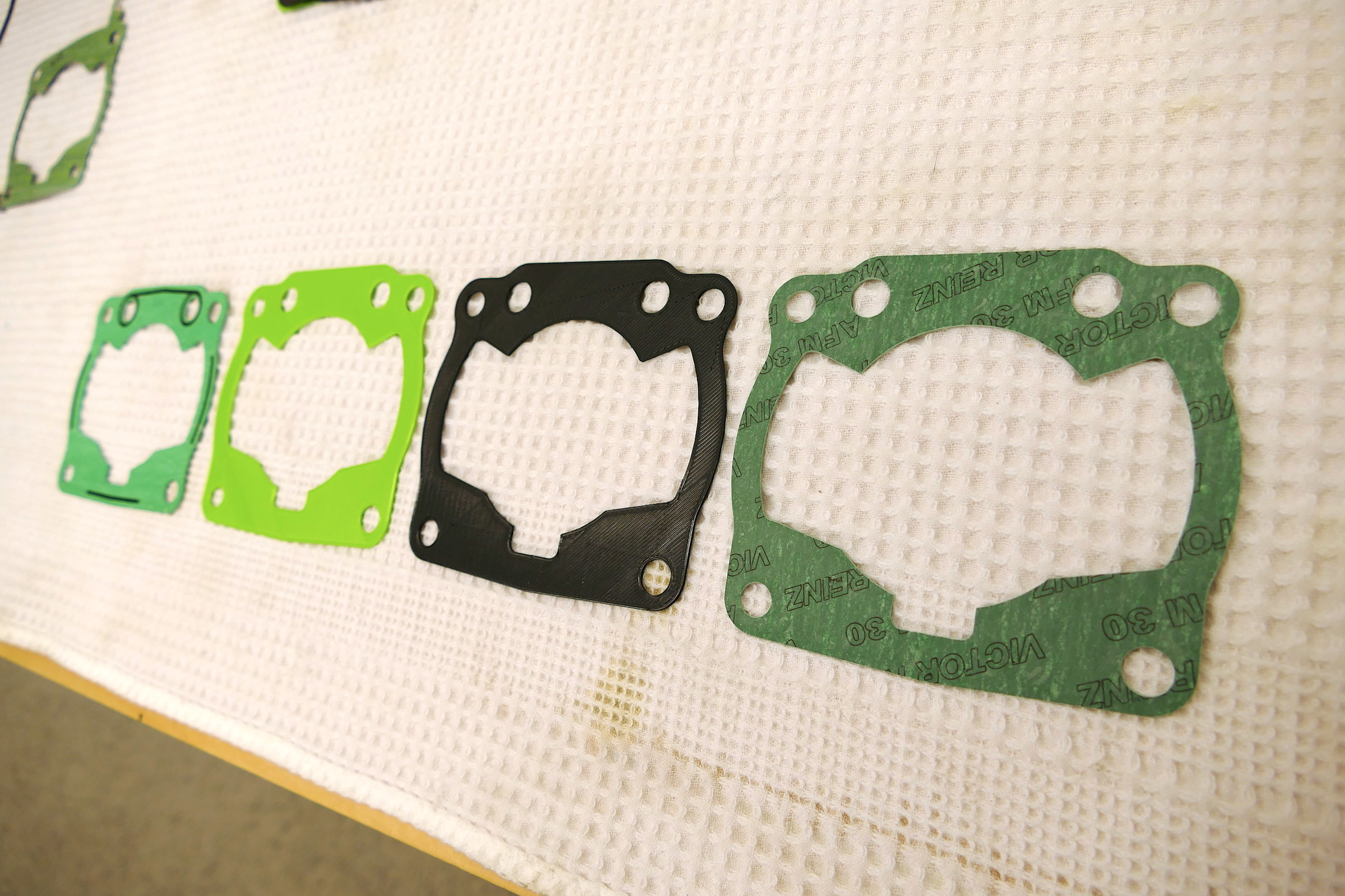 left to right: original Honda gasket, 1st prototype, 2nd prototype, production gasket